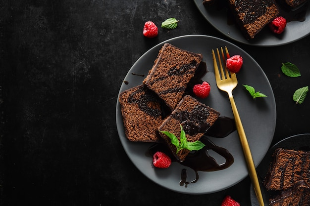 Chocolate cake served with chocolate sauce