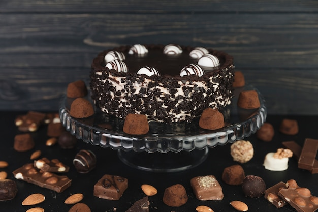 Chocolate cake surrounded by chocolate truffles and bonbons