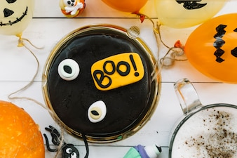 Chocolate cake surrounded by Halloween attributes