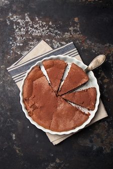 Chocolate cake topped with cocoa