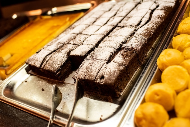 Chocolate cake on a tray in a self service restaurant