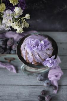 Chocolate cake on vintage balance and lilac flowers