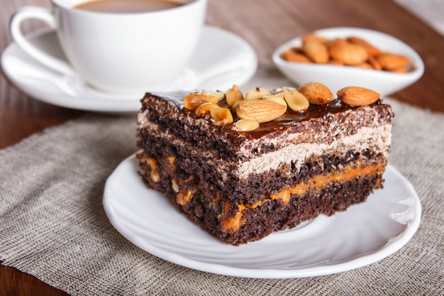 Chocolate cake with caramel, peanuts and almonds