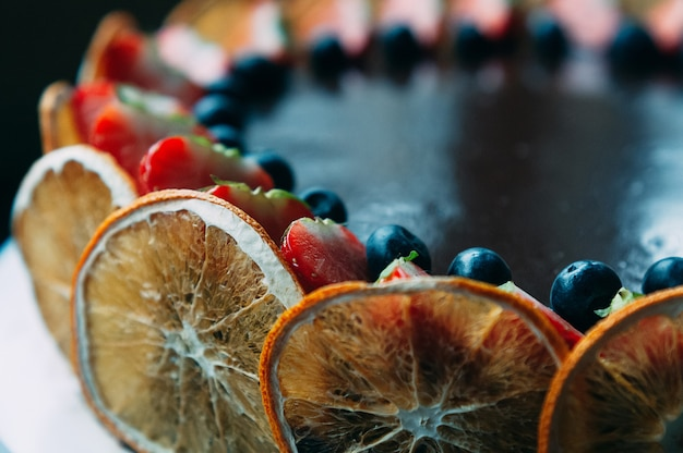 Chocolate cake with fruit, selective focus