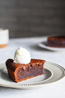 Chocolate cake with vanilla ice cream on a plate