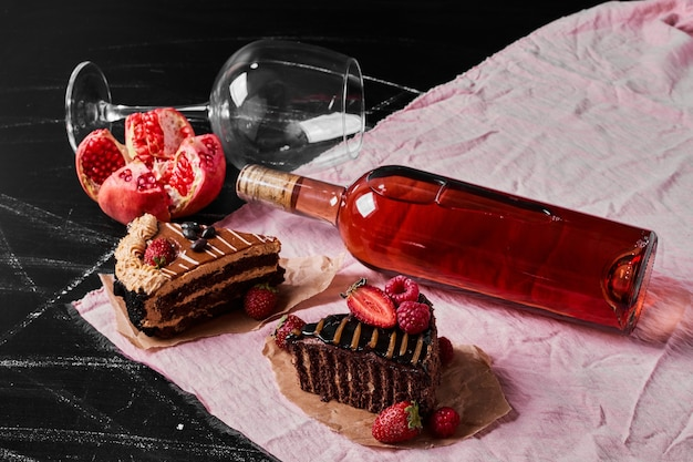 Chocolate cake with wine on black