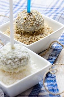 Chocolate cakepops with nuts and coconut flakes