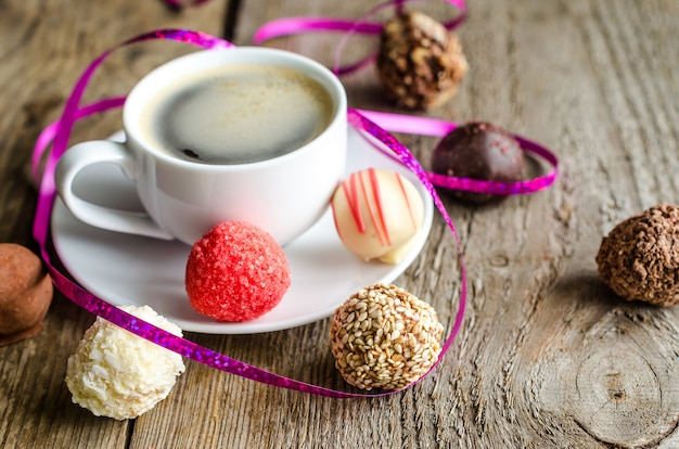 Chocolate candies and cup of coffee