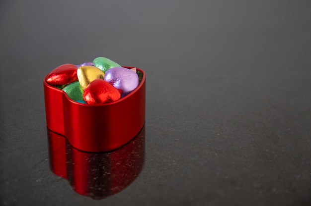 Chocolate candies in multicolored foils