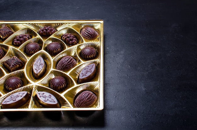 Chocolate candy in a box on a dark background