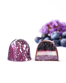Chocolate candy in a cut on a white background blueberry and lavender