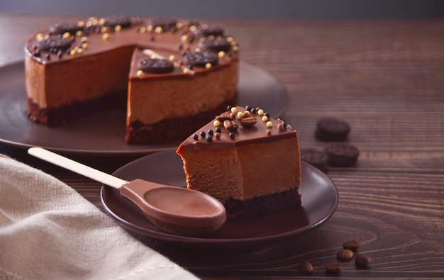 Chocolate cheese cake on the wooden table.