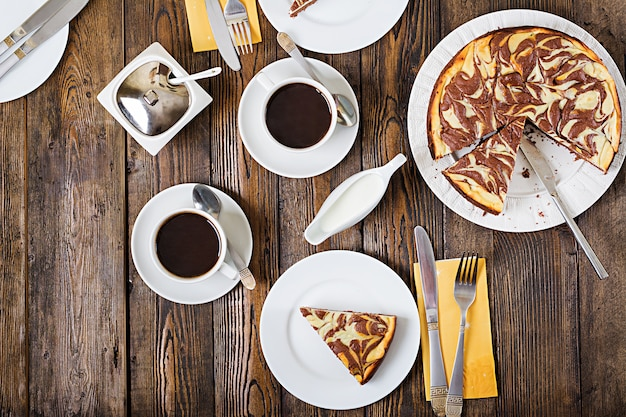 Chocolate cheesecake and coffee on wooden background. cup coffee and cheesecake.