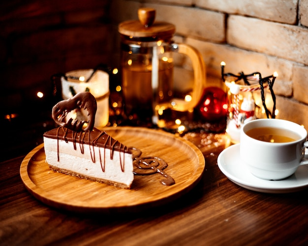 Chocolate cheesecake and a cup of flavored tea