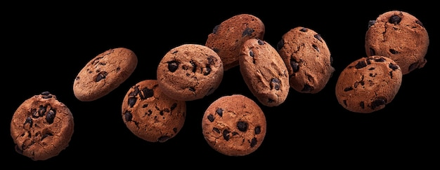 Chocolate chip cookies falling over black background, flying biscuits