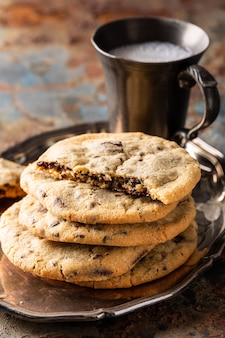 Chocolate chip cookies on old rusty blue table. american cuisine. copy space