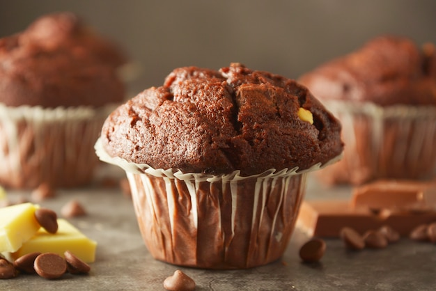 Chocolate chip muffin with chocolate bar.