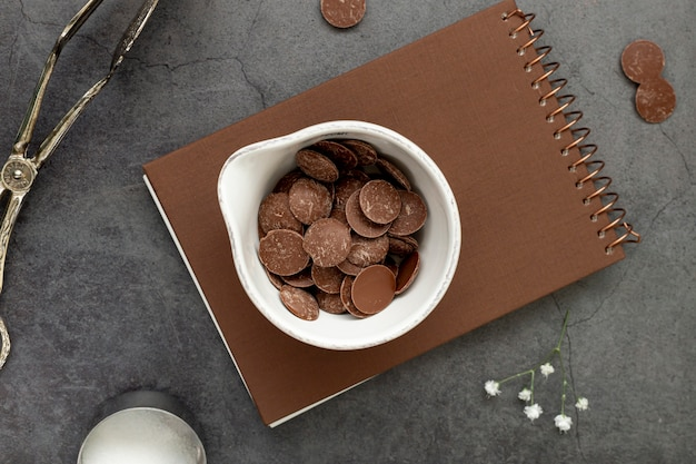Chocolate chips on a brown notebook