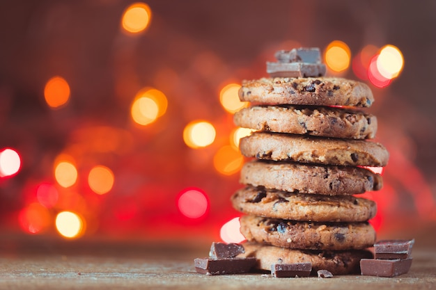 Chocolate chips cookies with crumbs on wooden table