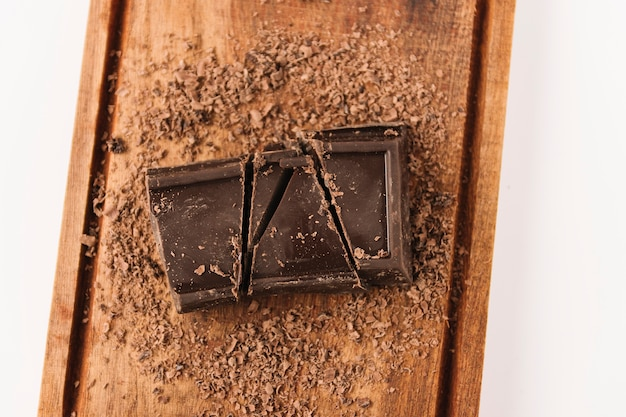 Chocolate between chocolate chips on chopping board