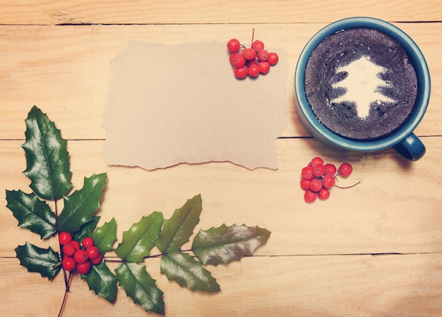 Chocolate christmas pudding on a wooden background