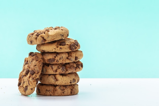 Chocolate chunk cookies on bright blue