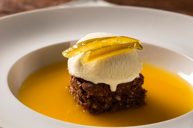 Chocolate cookie with ice cream and orange sauce