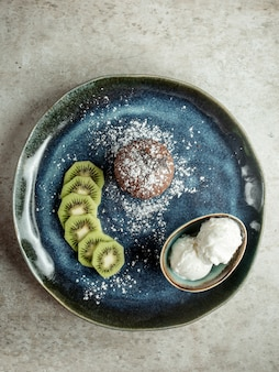 Chocolate cookie with sliced kiwi and ice cream