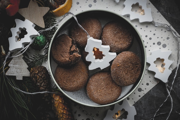 Chocolate cookies on a christmas background in new year decorations top view