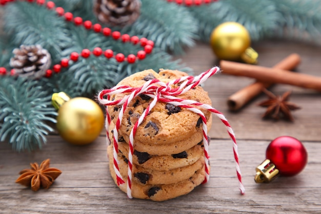 Chocolate cookies and christmas decoration on grey wooden