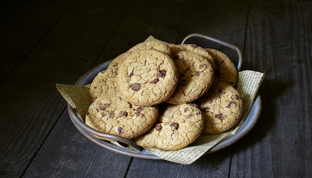 Chocolate cookies on a dark wooden table
