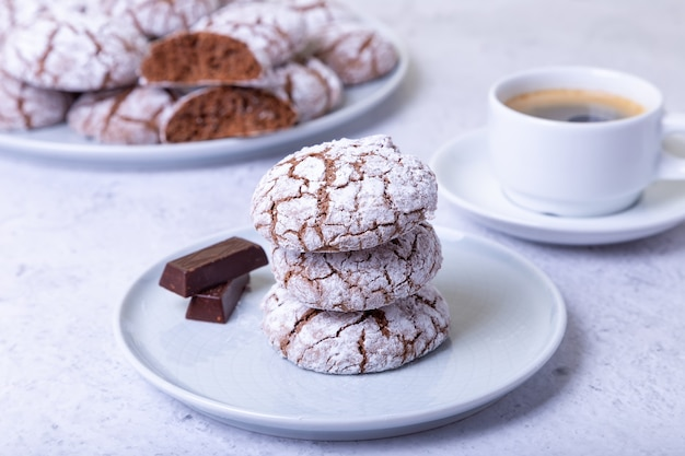 Chocolate cookies with cracks, strewed with icing sugar