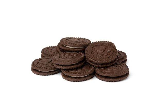 Chocolate cookies with milk filling isolated on white