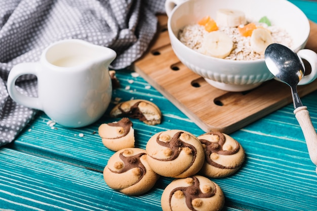 Chocolate cookies with oatmeal bowl on the table