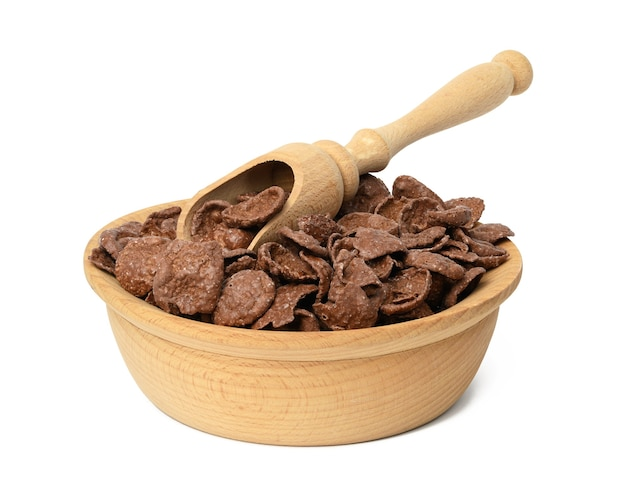Chocolate cornflakes in wooden plate isolated on white background, dry morning breakfast