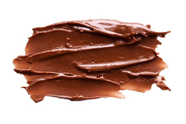 Chocolate cream strokes isolated on white background