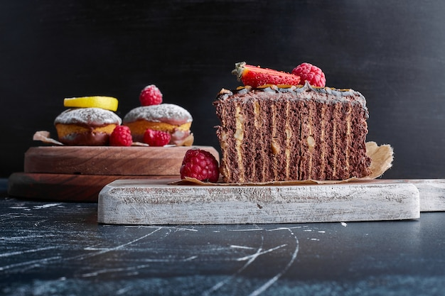 Chocolate crepe cake on a wooden board.