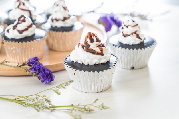 Chocolate cup cake with whipped cream