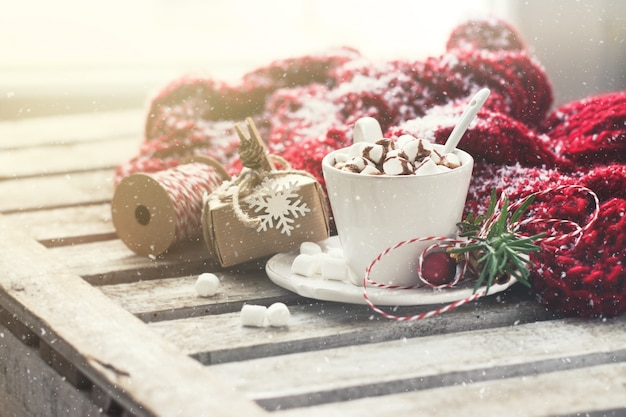 Chocolate cup with marshmallows and christmas decorations