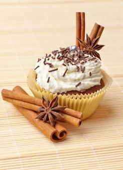 Chocolate cupcake with whipped cream and cinnamon