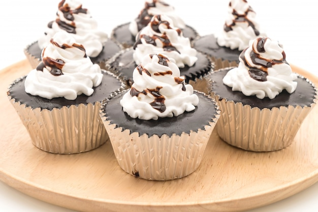 Chocolate cupcake with whipped cream