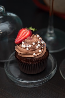 Chocolate cupcakes with strawberry.