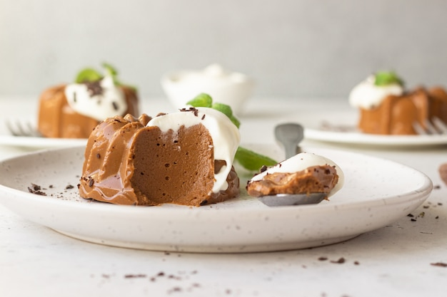 Chocolate dessert decorated with whipped cream, grated chocolate and mint. panna cotta.