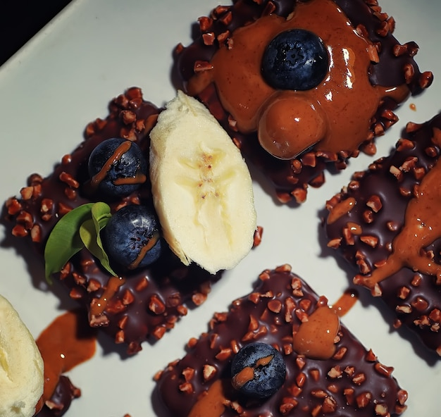 Chocolate dessert with nuts and fresh berries sweet snack for coffee biscuit