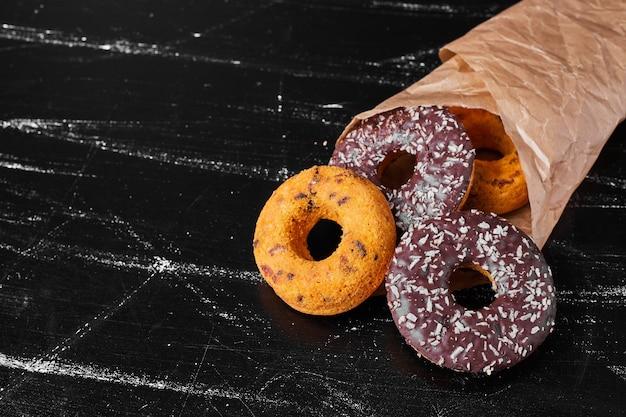 Chocolate doughnuts in a paper wrap.