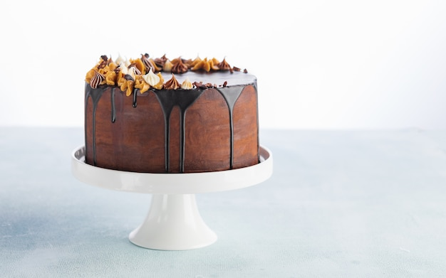 Chocolate drip cake with melting chocolate and peanut for a birthday or celebration.