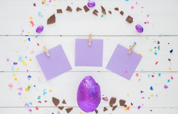 Chocolate easter egg in foil with small papers