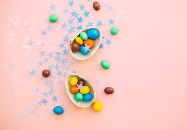 Chocolate easter eggs with colorful candies