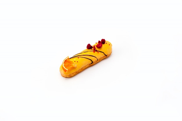 Chocolate eclair with fruit decor isolated