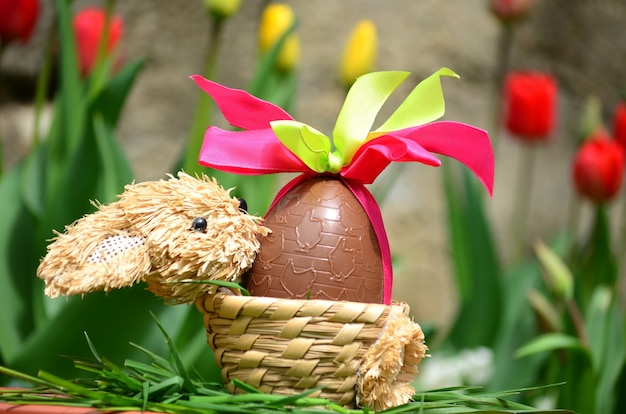 Chocolate egg with decorative bows